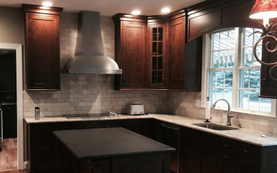 What is the first step in a kitchen remodeling project?